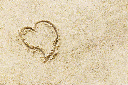 sand writing: Love sign writing on sand beach. Stock Photo