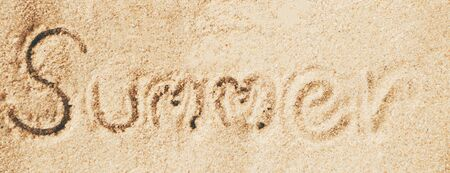 sand writing: Summer text writing on sand, Relax concept. Stock Photo