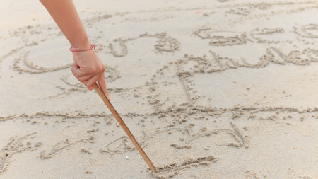 away from it all: Writing in Sand Stock Photo