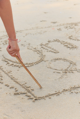 sand writing: Writing in Sand Stock Photo