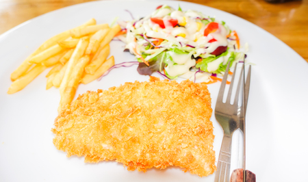 chicken chop: chicken chop, French fries and vegetables