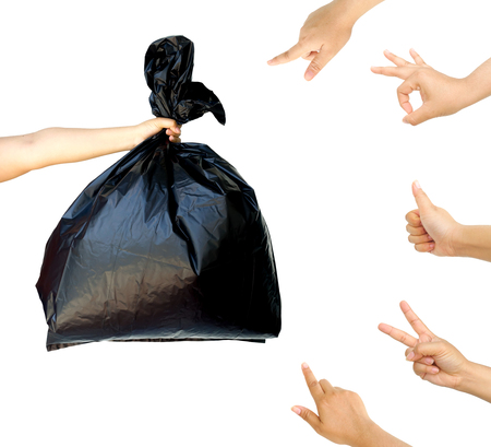 accepting: woman hand pointing and accepting at woman hand holding garbage bag isolated on white background, cleaning concept.