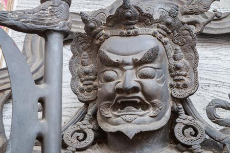 nontaburi: chines statue on door of temple at nontaburi, Thailand.