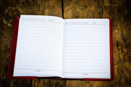 spread sheet: Notebook blank open for text on text old wood background
