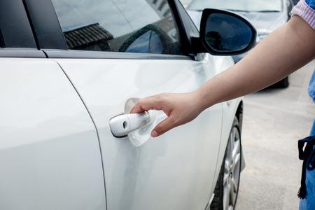 open car door: Close-up woman hand open car door