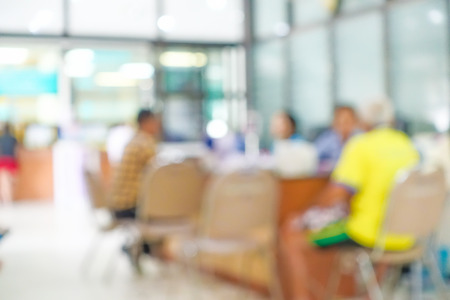 healthcare visitor: Blurred image of unidentified people and patient waiting doctor or medicine in hospital. Stock Photo