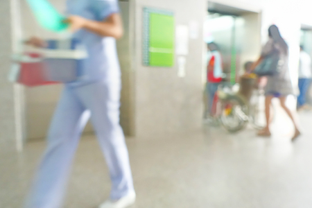 Blurred image of unidentified people and patient waiting doctor or medicine in hospital. Standard-Bild