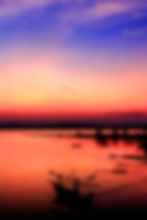 playas tropicales: Blurred image of colorful sunset on the beach background.