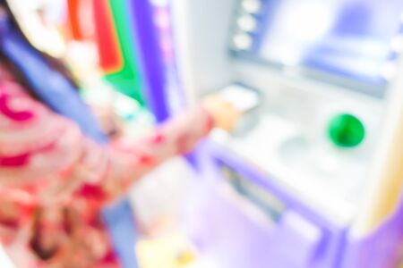automatic transaction machine: Blurred image of woman in bank use ATM machine for take money or do something about financial.