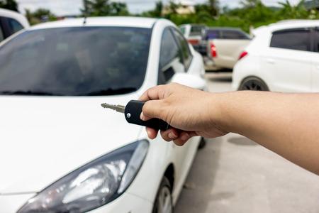 open autocar auto: Human hand use key to lock or unlock car