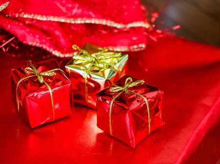 antique background: Christmas Present wrapped in red paper Stock Photo