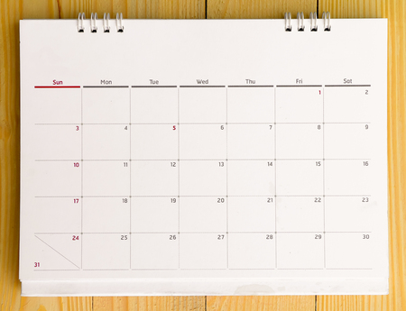 Close up of calendar 2015 on wooden table.