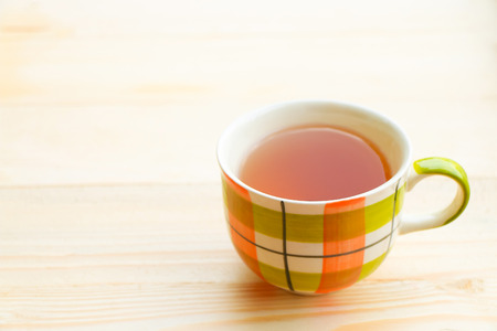 herbal background: Cup of tea on bright wooden background Stock Photo