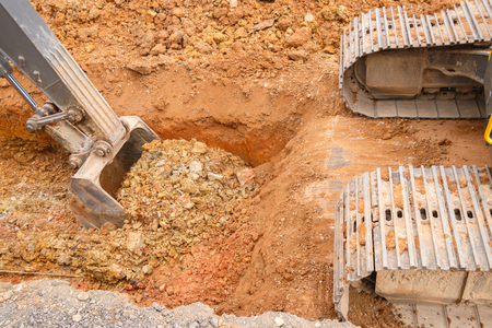 crane bucket: Road construction site