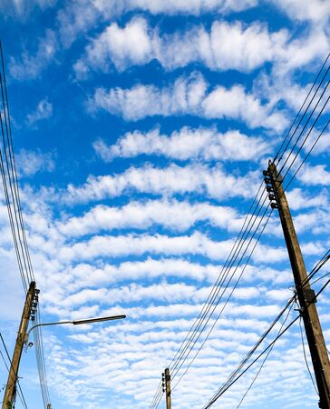 wire mess: Electricity post with overgrown wire on sky background. Stock Photo