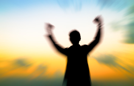freedom concept: Silhouette of man showing his hand on soft brown background, Successful business concept. Stock Photo