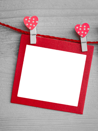 pack string: heart and blank paper card on wooden background. Stock Photo