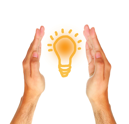 gag: Two male hands holding writing lamp on white background, idea concept. Stock Photo