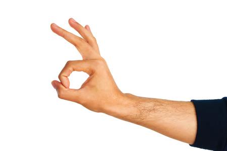 okay: Man hand showing sign Okay on white background. Stock Photo