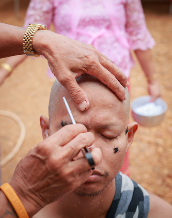 make belief: Male who will be monk cut hair for be Ordained. Thailand on July 6, 2014