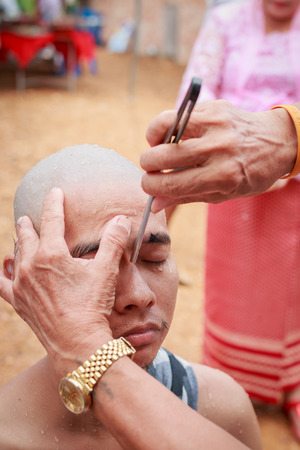 make belief: Male who will be monk cut hair for be Ordained. Stock Photo