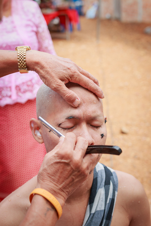 ordain: Male who will be monk cut hair for be Ordained. Stock Photo