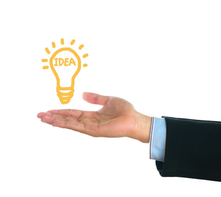 shiny suit: male hand holding writing lamp on white background, idea concept. Stock Photo