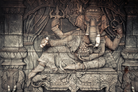 Elephant god statue on public temple wall in Thailand Stock Photo