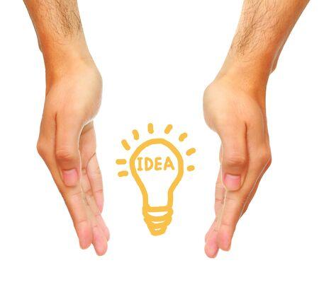 kilowatt: male hand holding light bulb on white background, idea concept. Stock Photo