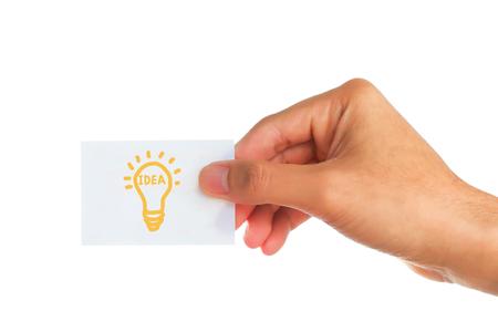 mannelijke handen houden papieren schrijflamp op witte achtergrond, idee concept.