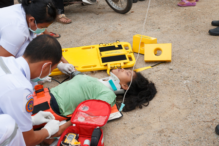 laceration: Chumpon, Thailand January 3 :Woman who accident by car was rescue by doctor and rescue on site of accident. Thailand on January 3, 2015