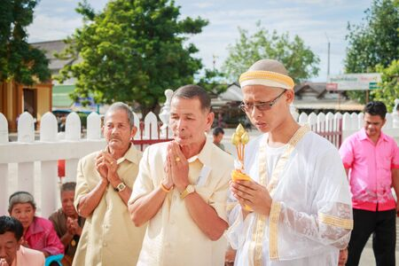 ordain: SONGKLA,THAILAND JULY 7 : Male will be ordained Buddhist walk to the temple. Thailand on July 7, 2014