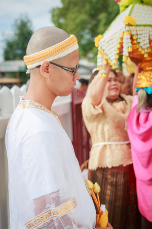 make belief: SONGKLA,THAILAND JULY 7 : Male will be ordained Buddhist walk to the temple. Thailand on July 7, 2014