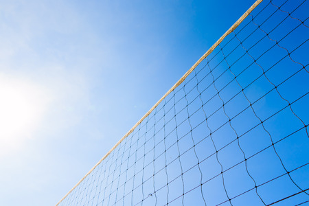 chained link fence: Wire mesh fence against blue sky Stock Photo