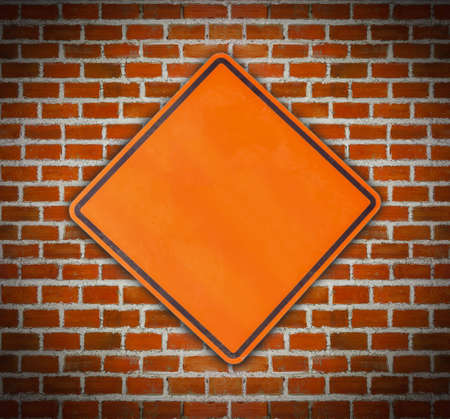 sign plate: blank sign plate on brick background Stock Photo