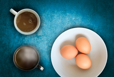 wooden insert: raw eggs with hot chocolate on wooden background, wooden with blank space for insert your texts or products.