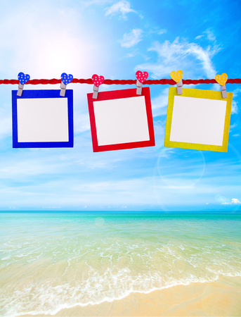 add text: colorful polaroid blank paper for add text or picture on the beautiful beach.