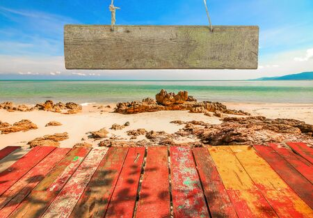 wooden insert: Beautiful sky with sea on the peaceful beach for relax with blank wooden signboard for insert text.