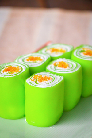 Close up green roll cake on plate