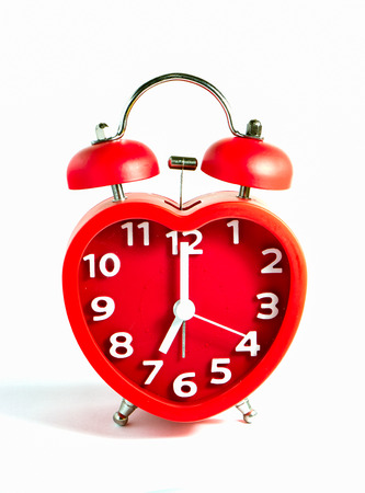 Red clock double bell mark at seven oclock isolated on white background