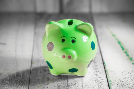 piggy bank on wooden tabletop Stock Photo