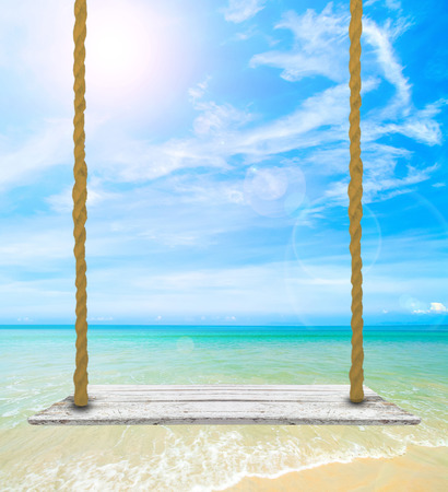 Beautiful sky with sea on the peaceful beach for relax with blank wooden signboard for insert text.