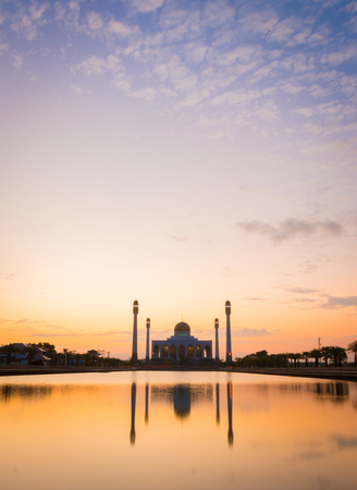 Sheikh: Silhouette of mosque at sunset with vintage filter tone.