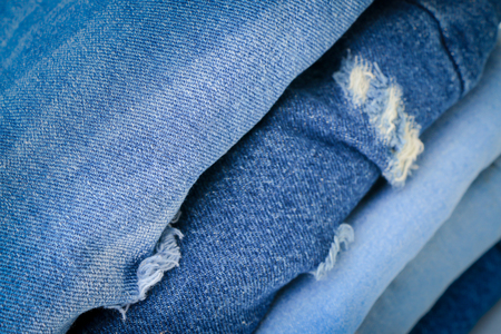 jeanswear: Stacked fashion blue jeans closeup