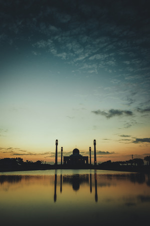silhouette of mosque on sunset sky background