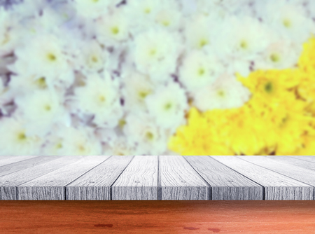 wood board table in front of summer landscape with double exposure of flower field bloom