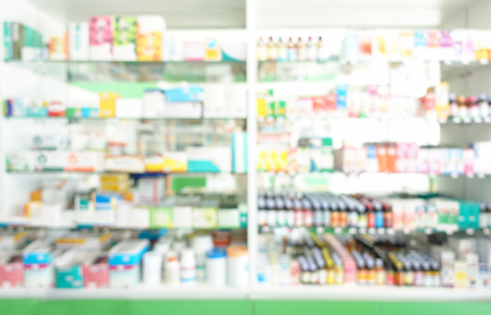 Medicines arranged in shelves at pharmacy drug shop