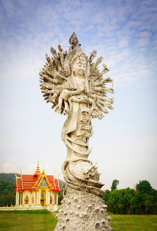 Goddess of mercy with sky background at public temple in Thailand