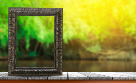 photo album: old picture frame for texts display on wooden tabletop with blurred fresh nature background Stock Photo