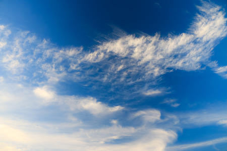 Blue sky background on sunny day with clouds